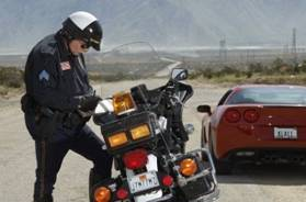 C:\Users\Michael\Desktop\3906365-traffic-cop-writing-against-motorcycle-on-country-road.jpg